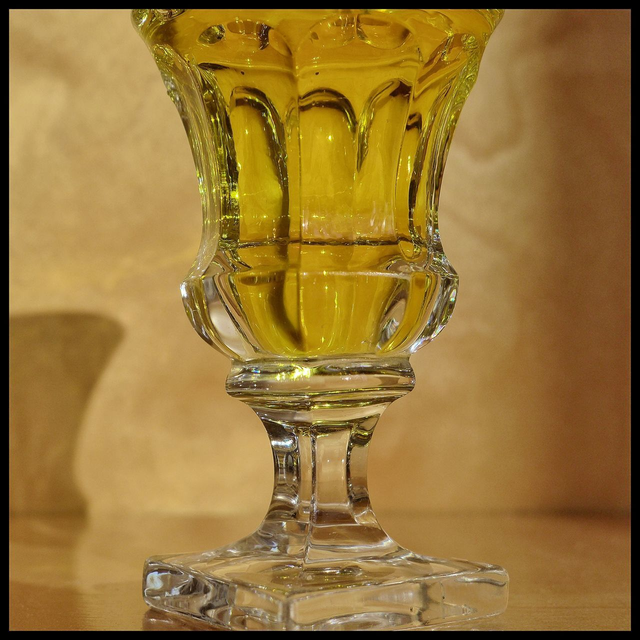 glass - material, auto post production filter, no people, close-up, indoors, transparent, table, transfer print, still life, food and drink, glass, drinking glass, focus on foreground, yellow, freshness, household equipment, food, single object, studio shot, ornate