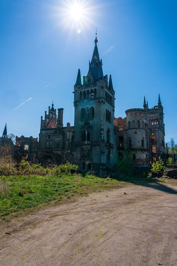 Castle Koppitz in Poland, old ruin. Castle Koppitz Poland Old Old Ruin Architecture Building Exterior Built Structure Sky Building Religion Spirituality Place Of Worship Belief Sunlight Nature Sun Sunbeam History Day No People The Past Lens Flare Outdoors Spire