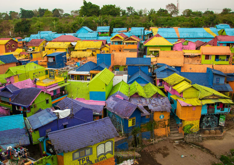 High angle view of multi colored houses in village