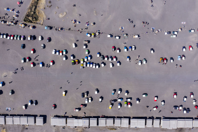 Aerial view of cars on road at sunny day