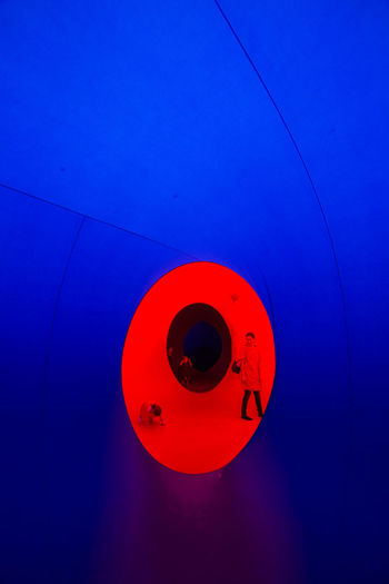 High angle view of red light on blue wall