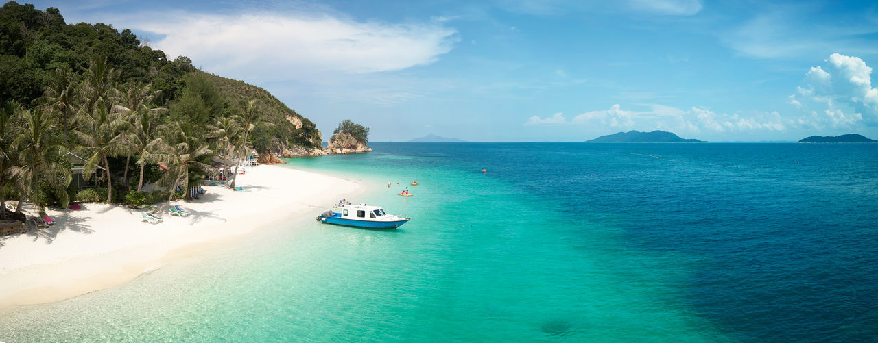 Crystal clear and turquoise sea water of the tropical sea . Bay Beach Beautiful Blue Calm Caribbean Chair Coast Coastline Coconut Day Dream Hot Idyllic Island Lagoon Malaysia Nature Nobody Ocean Outdoor Palm Panorama Paradise Parasol Plant Rawa Relax Resort Sand Scenery Scenic Sea Seascape Shore Sky Speed Boat Summer Sun Sunlight Sunny Tourism Tranquil Travel Tree Tropic Tropical Vacation Water Yacht