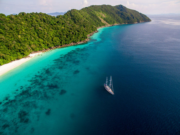 Sailboat at anchor in the remote mergui archipelago of myanmar.