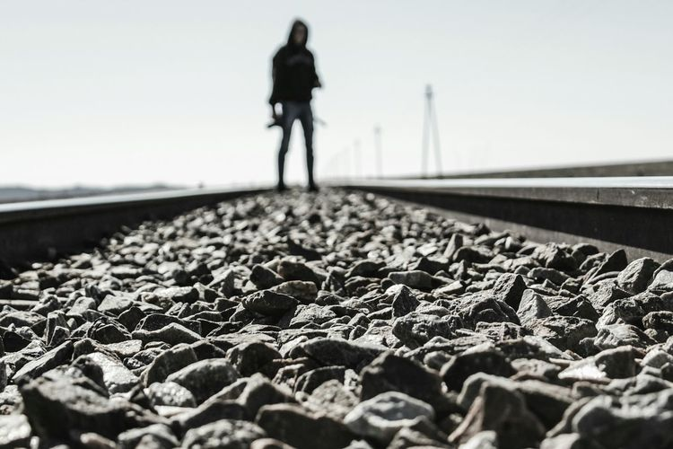 Surface Level Railroad Track Walking One Person Adult One Man Only Adults Only Transportation Winter People Full Length Day Only Men Standing Outdoors Sky Human Body Part Low Section Young Adult Mystery Faces Of Africa South Africa Faces Of EyeEm EyeEm Train Platform Breathing Space The Week On EyeEm