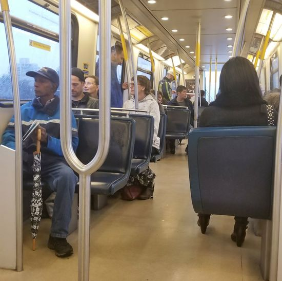 Riding on the Skytrain in Burnaby B.C. Canada. Transportation Train - Vehicle Subway Train People Canada B.C Burnaby Bc Transportation Public Transportation Sitting Railroad Track Connected By Travel