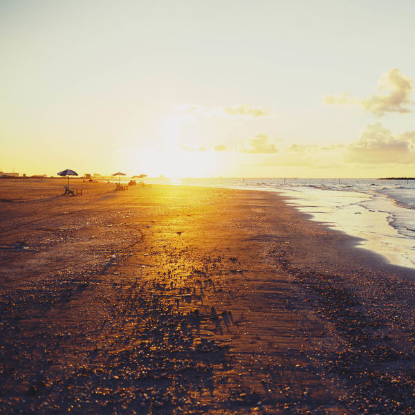 Beach Beach Sunset Beauty In Nature Day Golden Sunset Golden Sunsets Nature No People Outdoors Sand Scenics Sea Sea Shells Sky Sun Sunbeam Sunlight Sunset Sunsets Ventage Ventana Water