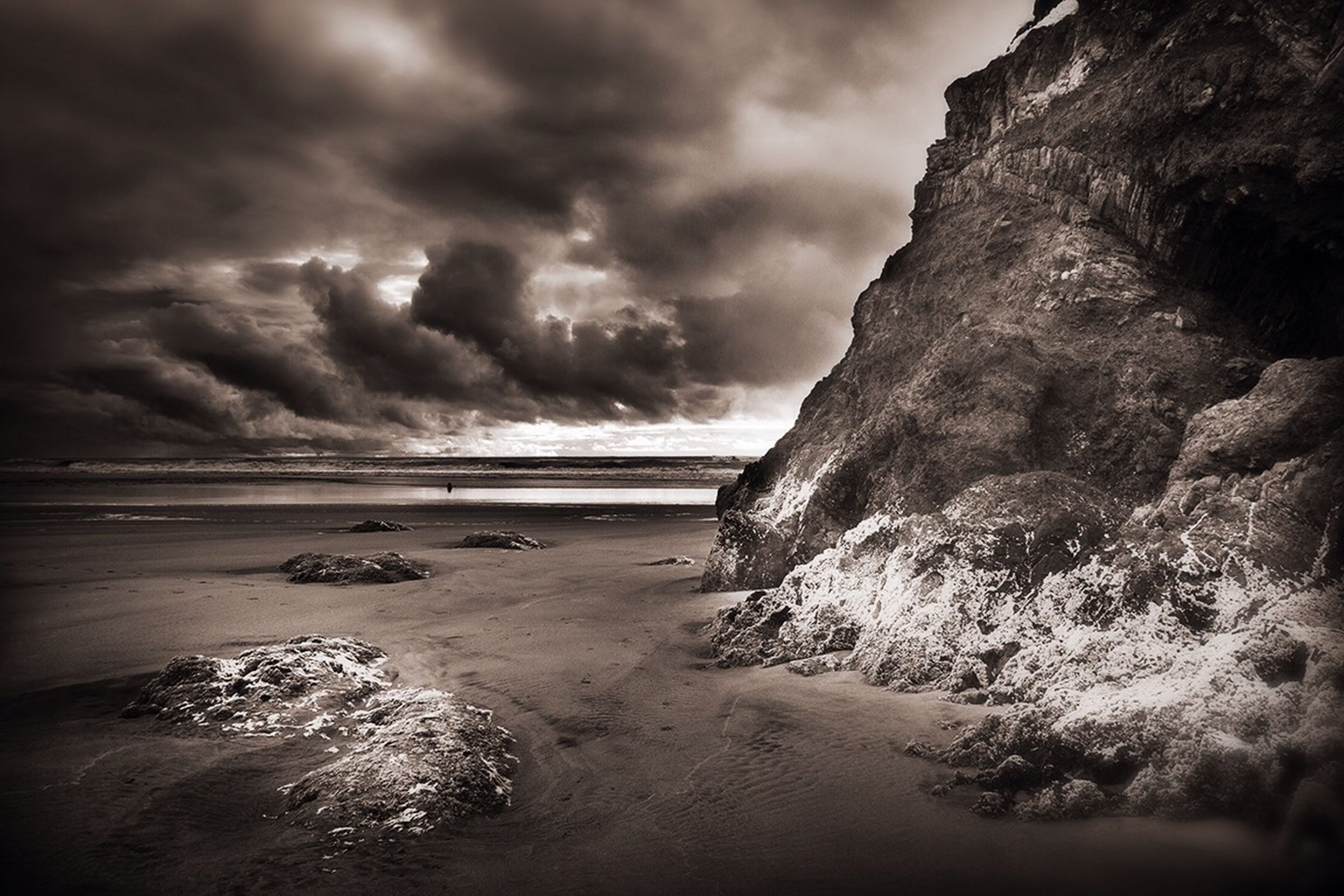sky, sea, water, beach, cloud - sky, tranquil scene, tranquility, scenics, cloudy, beauty in nature, nature, horizon over water, shore, rock - object, rock formation, cloud, sand, overcast, idyllic, coastline