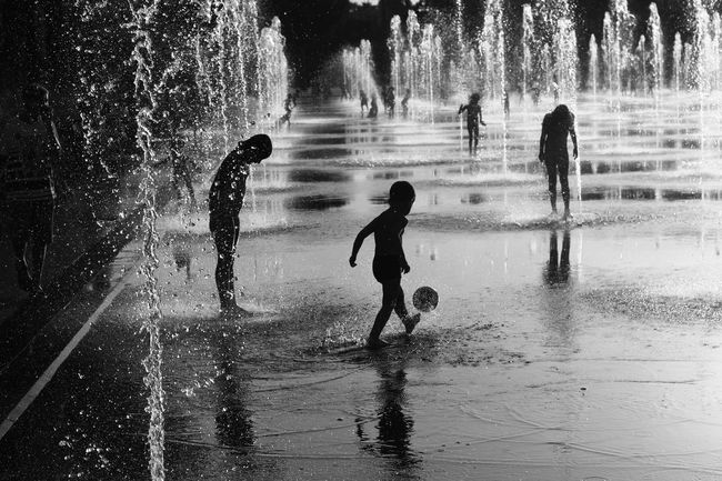 Water Splashing Real People Silhouette Boys Motion Outdoors Full Length Lifestyles Day Spraying People Monochrome Streetphotography_bw Bw_lover Black And White Photography Nice / Nizza Playing Playground Boy Nice, France The Week On EyeEm EyeEmNewHere City Childhood #FREIHEITBERLIN