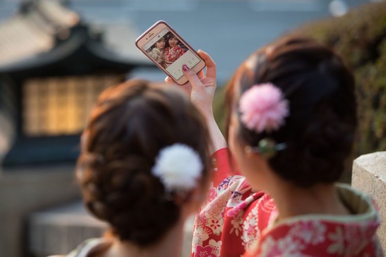 Girls in kimono taking selfie Japan Selfie Girls Kimono Headshot Portrait Women Holding Communication Smart Phone Wireless Technology Mobile Phone Females Child Rear View Portable Information Device Activity Leisure Activity Childhood Photography Themes Technology Togetherness Two People Hairstyle Outdoors Positive Emotion The Street Photographer - 2019 EyeEm Awards