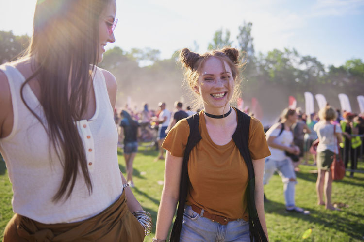 Woman laughing and enjoying music festival Friends Women Music Festival Smiling Traditional Festival Party Music Traveling Carnival People Summer Outdoors Dance Coachella Valley Fun Entertainment Boho Portrait Enjoyment Happiness Beautiful People Young Adult Adult Live Event Popular Music Concert Fashion Fashionable Happiness Joy Holiday Look At Camera Toothy Smile Positive Emotion Sunny Sunlight Copy Space Youth Culture Weekend Activities Young Women