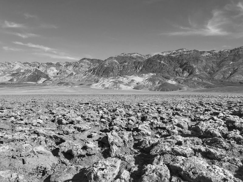 Black and white landscape of mountain range at Death Valley National Park Devils Golf Course Death Valley National Park Black And White Nature Sky Outdoors Scenics Day Beauty In Nature Landscape Mountain Arid Climate No People Tranquility