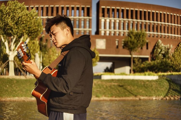 Artist Autumn Nature Singer  Winter Casual Clothing Causal Guitar Guitarist Hoodie Lake View Musician Sunset