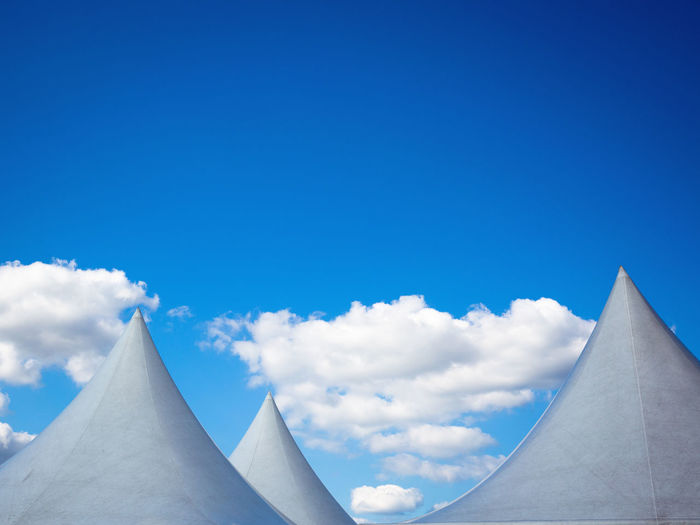 Low angle view of clouds against blue sky
