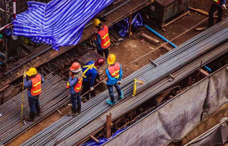 Group of people working at construction site
