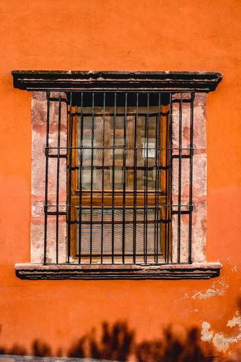 Pattern, Texture, Shape And Form Pattern Abstract Abstract Photography Door San Miguel De Allende Mexico Colorful Colors Geometric Shapes Streetphotography Street Photography Magic Moments Built Structure Architecture Building Exterior No People Day Outdoors Metal Window Wall - Building Feature Grid Grate Wood - Material Protection Rusty Orange Color Security Security Bar Building Safety Metal Grate