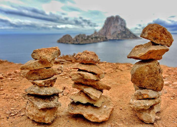 Stacks of rocks on shore