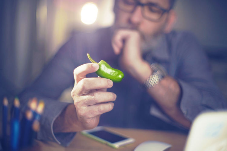 Brainstorming Close-up Concept Creative Creative Power Eating Food Green Color Human Hand Idea Ideas Indoors  Jalapeños Lens Flare Paprika Peppers Sitting Spice Spicy Think Thinking