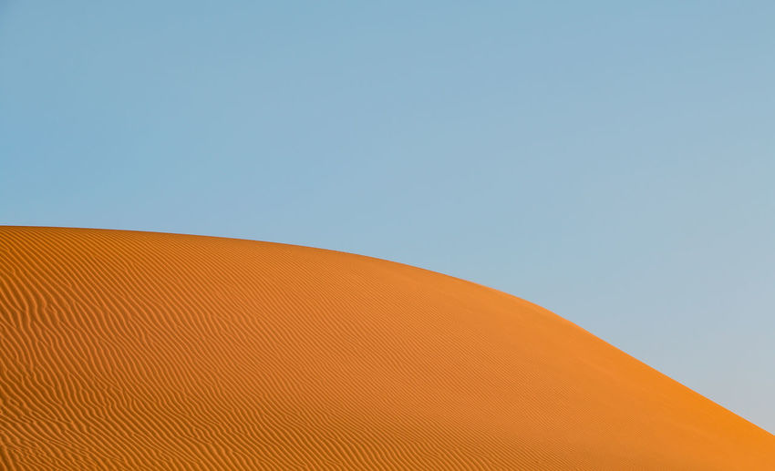 Sand & Sky Sky Clear Sky Nature Blue Brown Beauty In Nature Day No People Landscape Desert Land Outdoors Environment Sand Orange Sunlight Background Beauty In Nature EyeEmNewHere EyeEm Nature Lover Desert