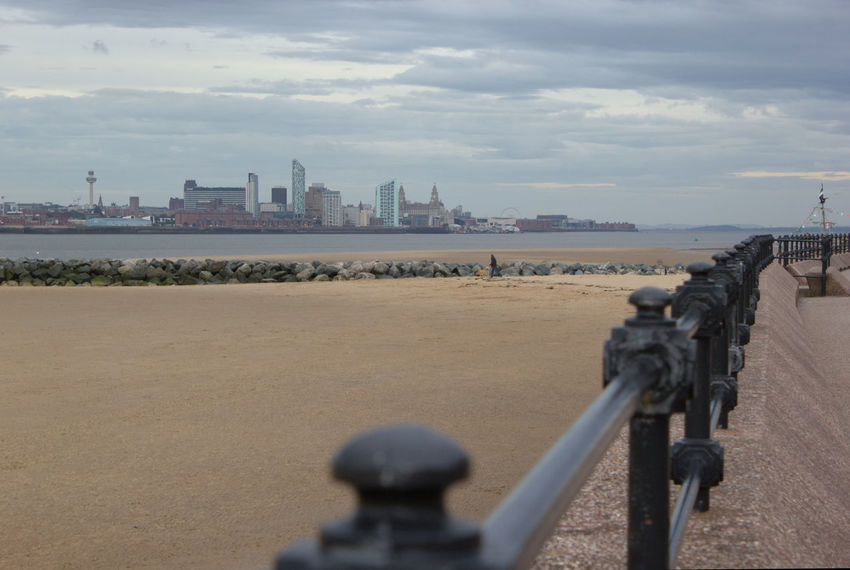 The view of Liverpool city skyline from New Brighton promenade Water Sky Cloud Railing Travel Destinations Built Structure River Architecture City Tranquility Tourism Tranquil Scene Cloud - Sky Outdoors Day Calm Scenics River Mersey Liverpool City City Skyline Sand Liverpool Cityscape Cityscape