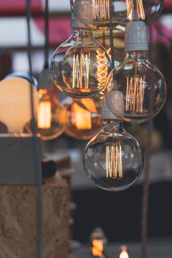 Close-Up Of Light Bulb Hanging Indoors