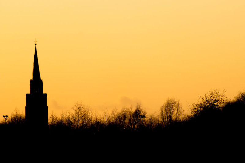 Walking in De schorre Architecture Building Exterior Built Structure Church No People Outdoors Place Of Worship Religion Shillouette Shilouette Silhouette Sky Sunset Tree