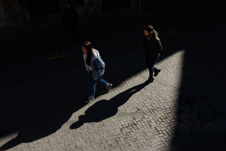 Candid Street Photography Streetphotography Light And Shadow Streetphoto_color Streetphoto Full Length Shadow Friendship Sunlight Togetherness Silhouette Focus On Shadow Paved Long Shadow - Shadow Friend