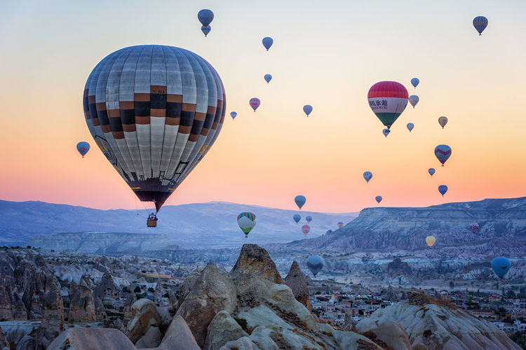 Hot Air Balloons Adventure Ballooning Festival Beauty In Nature Day Flying Hot Air Balloon Landscape Mid-air Mountain Multi Colored Nature No People Outdoors Rock - Object Rock Formation Rock Hoodoo Scenics Sky Sunrise Sunrise_sunsets_aroundworld Sunset Transportation Travel Destinations