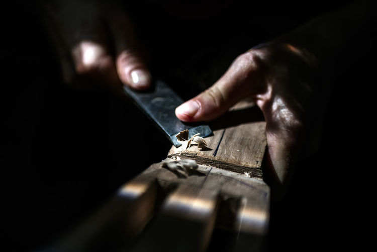 Unrecognized luthier woman in traditional workshop