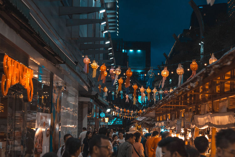 Street Photography Group Of People Crowd Illuminated Architecture Building Exterior Large Group Of People Night Built Structure Real People City Women Men Adult Lifestyles City Life Leisure Activity Lighting Equipment Walking Market Nightlife Street Market Consumerism