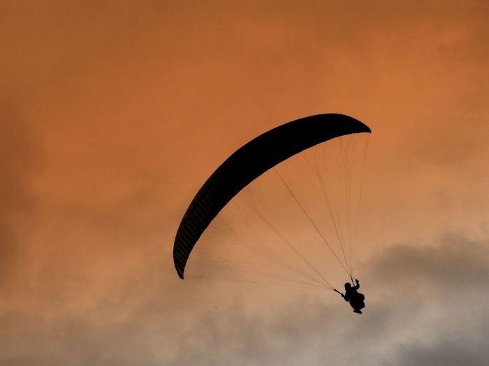 Rear View Of Parachuting Against The Sky