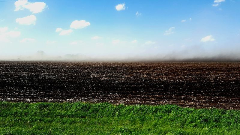 Dust storm sweeping Eastern Michigan. Sky Day Cloud - Sky Outdoors Field Agriculture Grass Rural Scenes Green Grass Blue Sky Nature Landscape No People Scenics Beauty In Nature Dust Storm Dust In The Wind Plowed Field Perspectives On Nature Colour Your Horizn