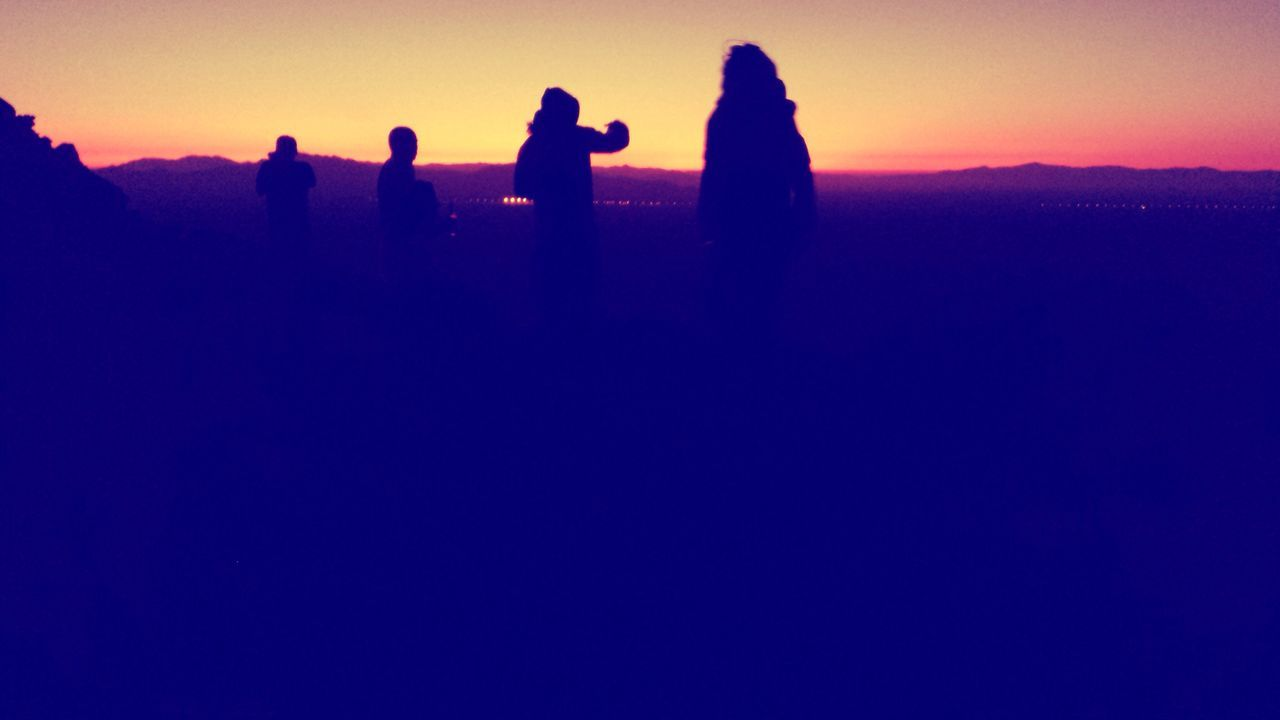 silhouette, real people, sunset, men, standing, lifestyles, leisure activity, nature, togetherness, outdoors, clear sky, beauty in nature, women, scenics, friendship, sky, day, people