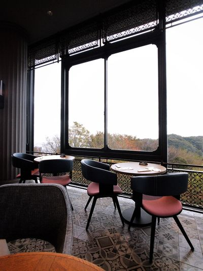 Cafe Located in a glass house Kobe Japan Window Table Seat Indoors  Glass - Material Chair Day No People Architecture