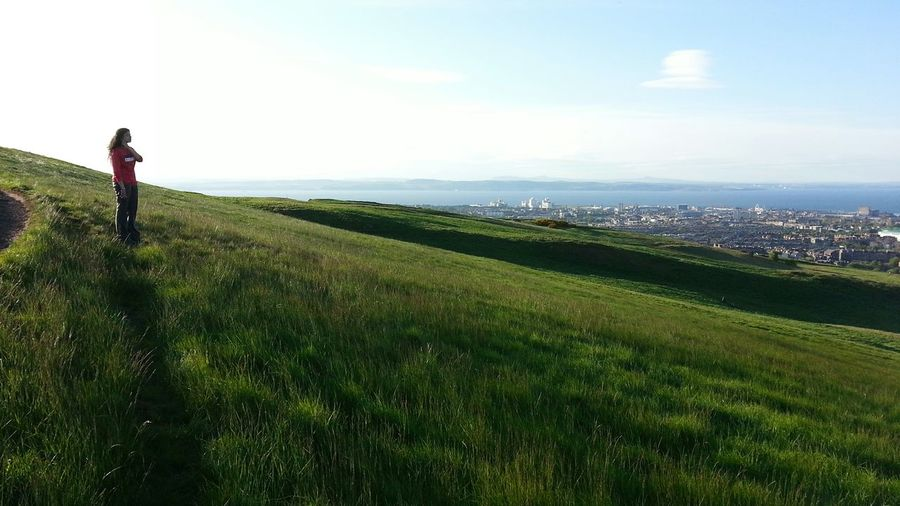 Soaking up the late Spring sun on a Hike through Edinburgh's Holyrood Park. May 2014. Holyrood Park Edinburgh Scotland Sun Sun On Grass Spring Summer Spring In Edinburgh May Firth Of Forth Scottish Landscape Female Nature Outdoors Travel United Kingdom Grassy Slope Hillside View Of The Sea Salisbury Crags