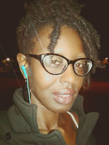 Portrait Eyeglasses  Real People Close-up One Person One Young Woman Only Lifestyles Downtown Ft. Lauderdale Leisure Activity Illuminated Sensuous Beauty Darksin Lesbian Browneyedgirl Beautiful Woman Darkskin & Lovely Eyeglasses  Melanin Queen PolyLesbian Pretty Me  Lgbt Solopoly Selfie Time