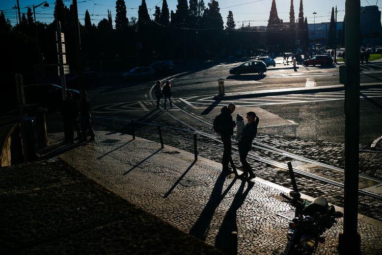 Shadow of woman on city street