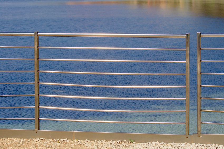 Background Barrier Blue Day Fence Full Frame High Angle View Metal No People Outdoors Pattern Protection Railing Safety Sea Security Water