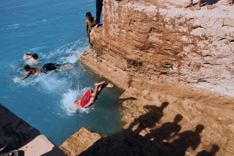 Rock - Object High Angle View Real People Men Leisure Activity Day Water Sunlight Nature Adventure Outdoors Lifestyles Women Beauty In Nature Adult People Cliff Jumping Dive Cliff Freedom Adults Only One Person Open Edit Swim Jump Be. Ready. Be. Ready.