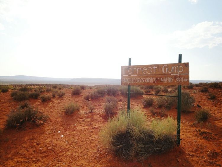 Forrest Gump Text Communication Western Script Landscape Tranquil Scene Sky Guidance Sign Information Sign Remote Non-urban Scene Information Tranquility Road Sign Capital Letter Countryside Solitude Signboard Scenics Plant Summer Road Tripping