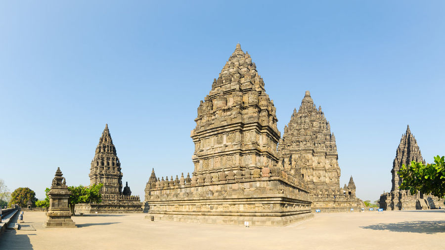 Panoramic view of temple against clear blue sky