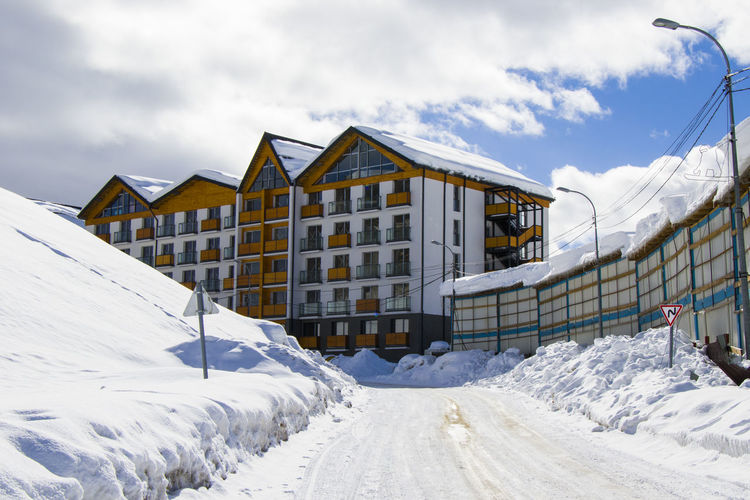 ski resort, snowy mountains and hostels.