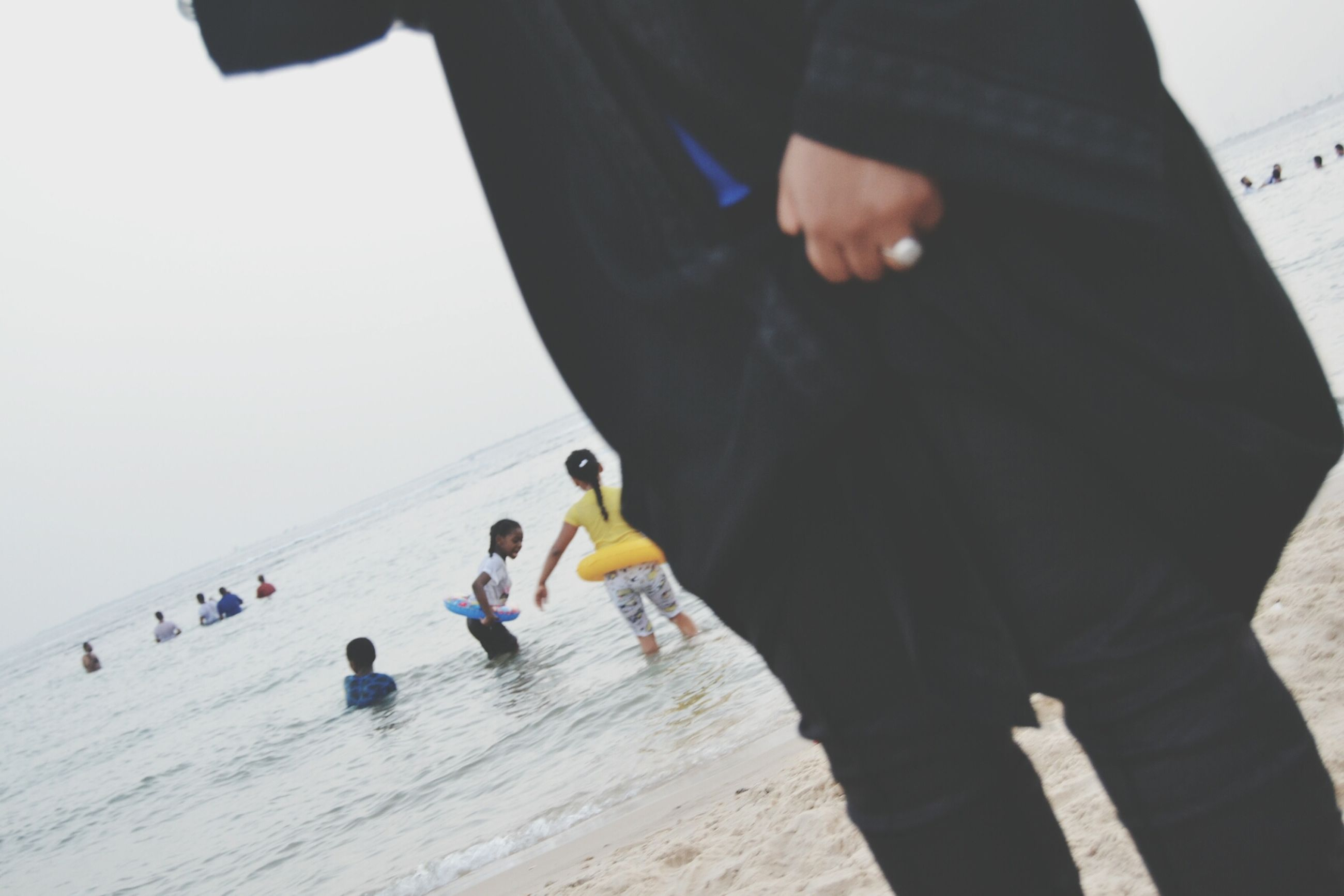lifestyles, leisure activity, men, casual clothing, togetherness, person, childhood, full length, boys, bonding, holding, girls, enjoyment, standing, walking, vacations, rear view