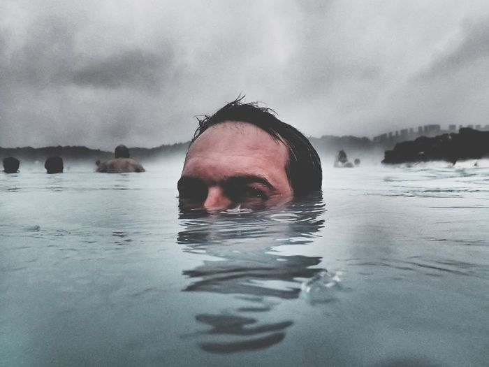 Portrait Of Man Swimming In Geyser