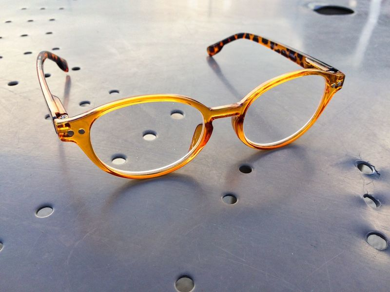 Glasses JGLowe EyeEm Selects No People Land Close-up Sand High Angle View Beach Shape Outdoors Day Still Life Circle Geometric Shape Metal Anthropomorphic Smiley Face Fashion Glasses Jewelry