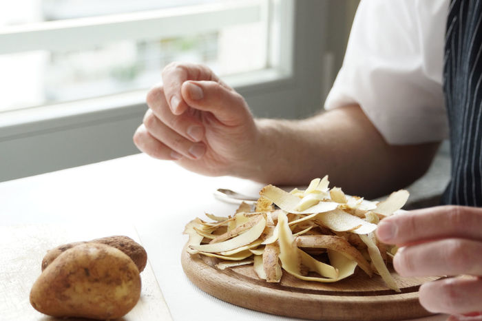Peeled potatoes Cooking Finished Food Food And Drink Healthy Eating Healthy Lifestyle Home Human Body Part Human Hand Kartoffel Kartoffelschalen Peels Potato Potato Peels Schalen Still Life