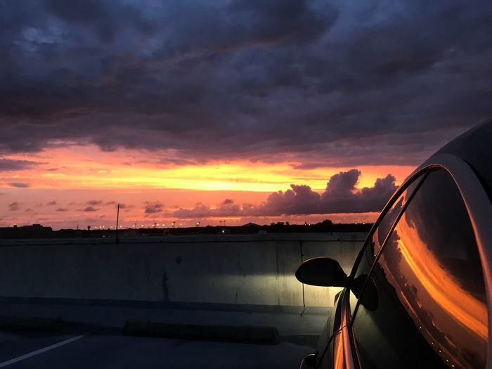 Car against sky during sunset