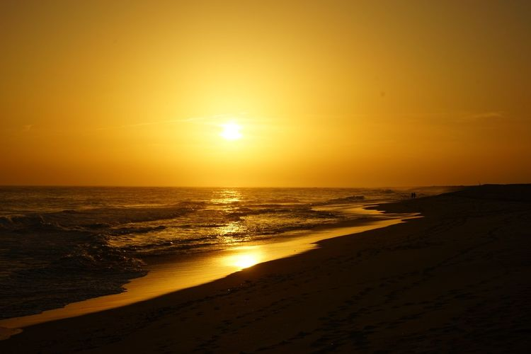 Sunset Togetherness Warm Water Wave Sea Sunset Beach Low Tide Horizon Sand Summer Beauty Romantic Sky Atmospheric Mood
