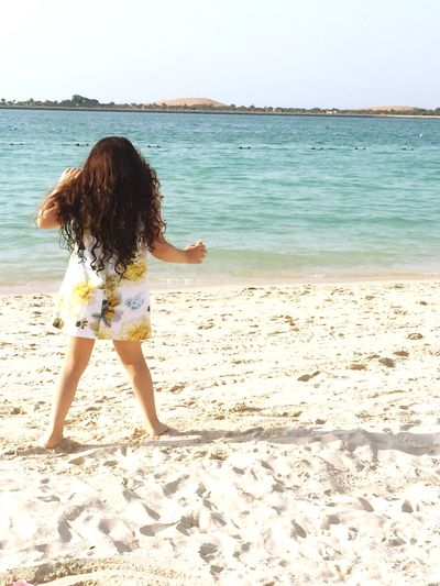 Beach Sea Leisure Activity Sand Real People One Person Rear View Full Length Standing Fun Lifestyles Water Vacations Childhood Nature Day Summer Outdoors Horizon Over Water Beauty In Nature Abudhabi Happybabygirl Happiness Kids Long Hair