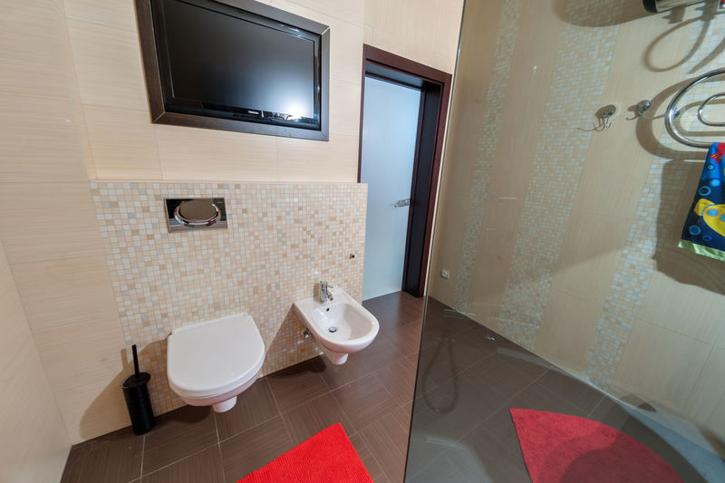Bathroom Home Domestic Bathroom Domestic Room Indoors  Home Interior Seat Flooring Toilet Bowl Toilet Hygiene Window Home Showcase Interior Mirror No People Wealth Luxury Chair Absence Tile Tiled Floor