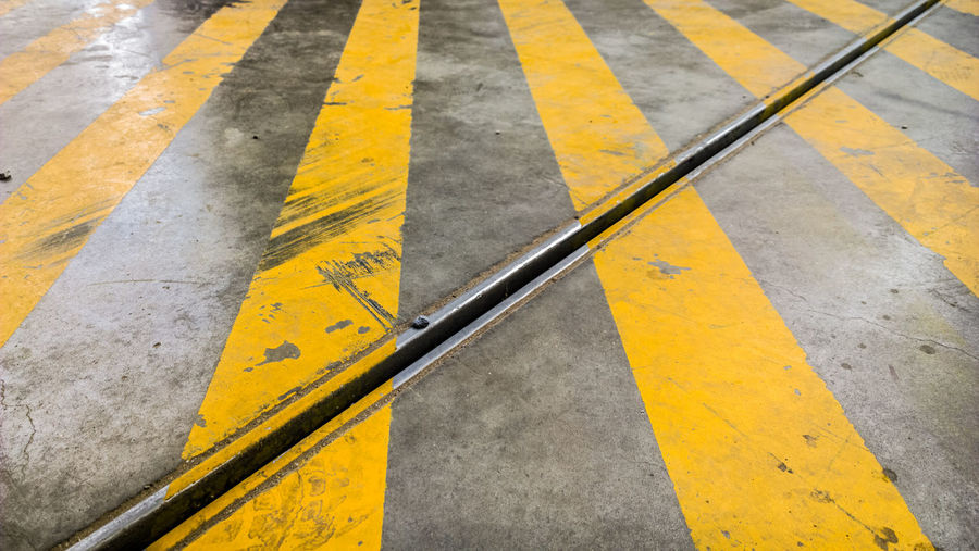 Yellow Road Marking Transportation Day Street High Angle View Outdoors Guidance Asphalt No People Road Close-up